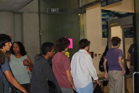 Students walk through a metal detector at North Atlanta High's new campus.