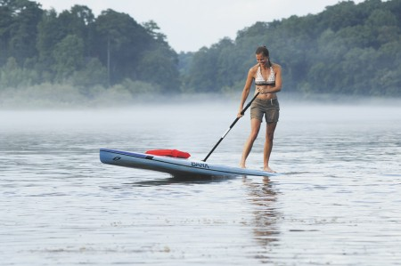 Patricia Fulton tries her hand at stand up paddleboarding on the Chattahoochee River. The sport, which uses boards 10-12 feet tall and long oars, has exploded in popularity in recent years.