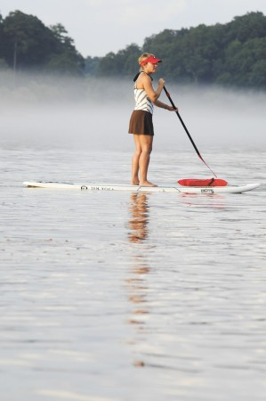 Samantha Black listens to stand up paddleboarding instructions at Morgan Falls Overlook Park on July 18 in Sandy Springs. Local companies offer lessons on the Chattahoochee River.