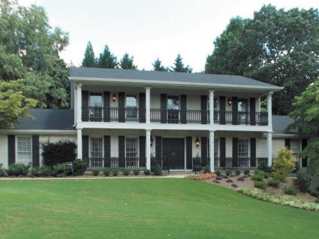 The Millers' Dunwoody home, a French Colonial revival, is on the tour. Built in 1971 and bought by the Millers in 1993, the Louisiana natives were drawn by the New Orleans flavor of the two-story front porch and wrought iron railings.