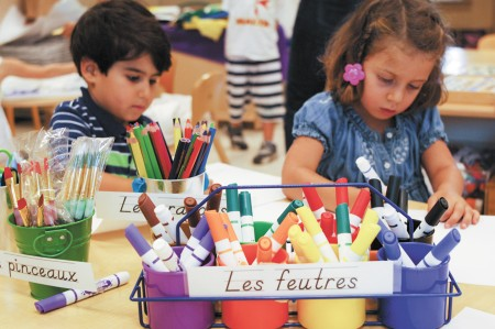 """Nicholas Thompson, left, and Antonella Pervanas enjoy preschool lessons taught exclusively in French at the Atlanta International School.  AIS says the program has been a """"phenomenal success."""""""