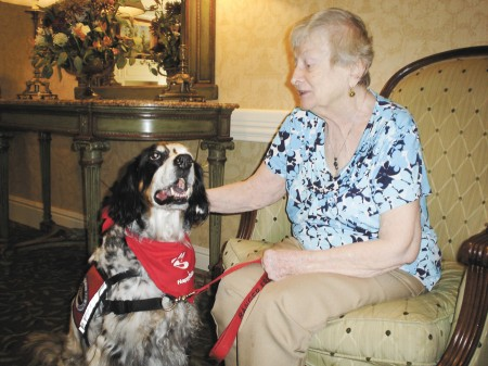 Marilynne McLaughlin gets some one-on-one time with Ranger at Canterbury Court.