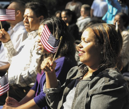 Muna Omar, right, joined others in becoming a U.S. citizen at a Chattahoochee River ceremony.