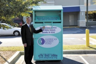 Ed Zito, a volunteer with American Kidney Services, points out the teal-colored collection bins that the nonprofit uses to collect donated items from around the metro area. This bin is located in the 6300 block of Roswell Road in Sandy Springs.
