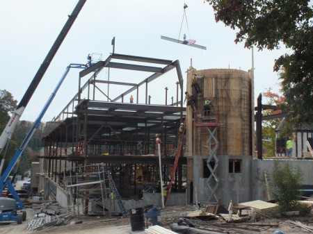 One of the final beams is lowered into place during construction of  Pace Academy's new Upper School building.