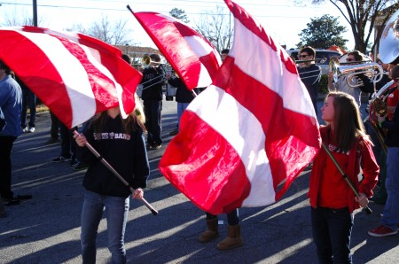 The Dunwoody High School band performed at Light Up Dunwoody on Nov. 24. Dolor guard members, left to right, Taylor Doolittle, Lauren Frost and Saralyn Wiggins led the way.
