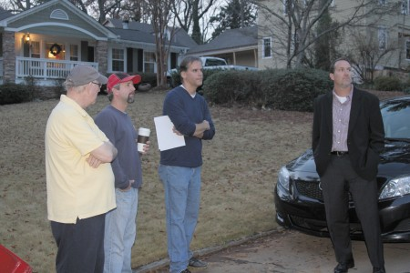 From left: Larry Cook, Dan Maloy, Carl Myers and Todd Varino talk about a controversial house under construction in their neighborhood.