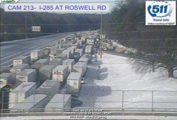 Trucks and cars still trapped on I-285 at the Roswell Road exit at Sandy Springs.