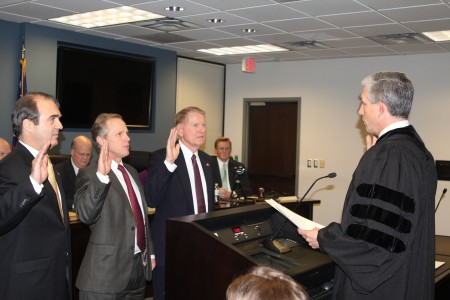 Georgia Supreme Court Justice David Nahmias, right, swears in Dunwoody City Council members Jim Riticher, left, Doug Thompson, center, and Denny Shortal, right, during the council's Jan. 2 meeting.