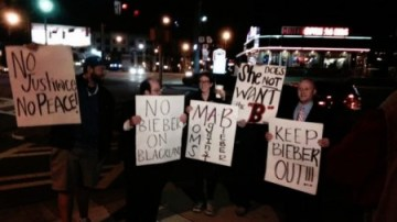 Baby, baby, baby no! Only five people turned up this morning to protest Justin Bieber's move to Buckhead (Photo courtesy CBS Atlanta)