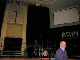 Senior Pastor Mack Hannah on the stage of Dunwoody Baptist Church's Worship Center.