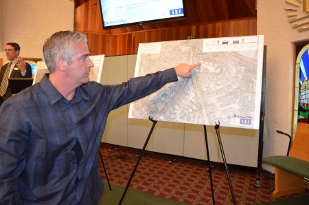 Jeff Kline points to map showing proposed improvements to intersection at Chamblee Dunwoody Road and Spalding Drive near his home. Kline was among residents attending a public meeting held Feb. 25 by  Dunwoody city officials at New Apostolic Church to discuss ways to improve safety at the intersection.