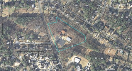 The site is located on the eastern side of Roberts Drive, approximately half a mile north of the intersection with Chamblee Dunwoody Road.