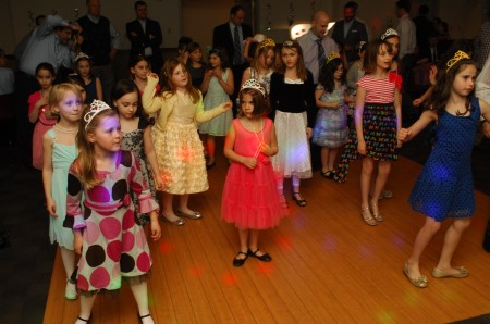 Girls decked out in brightly colored party dresses for the Father-Daughter Dance at the Marcus Jewish Community Center of Atlanta on March 23.