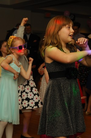Emma Fountaine, left, and Rachel Urbach dance up a storm March 23 during the Father-Daughter dance at the Marcus Jewish Community Center of Atlanta.