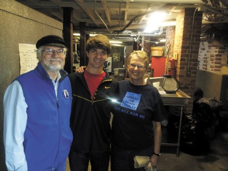 Peter Myer, center, with Eduard Loring, left, and Murphy Davis, right, at the Open Door Community facility.