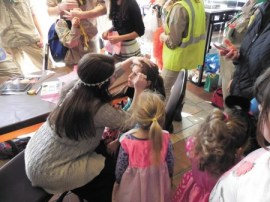 Participants prepare for a previous Purim parade at the Marcus Jewish Community Center.
