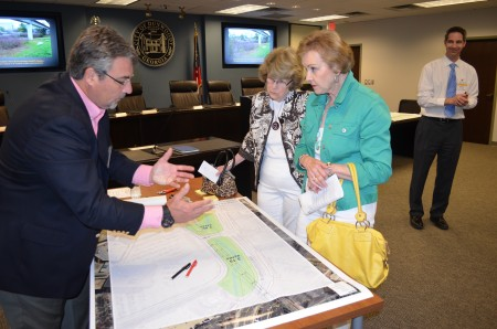 Consultant Ray Strychalski, left, discusses possible features of a proposed 5-acre Perimeter Park @ Dunwoody MARTA Station withDunwoody residents Jan Slater, center,  and Charlene Thurman, right, during a public meeting April 22 at Dunwoody City Hall.