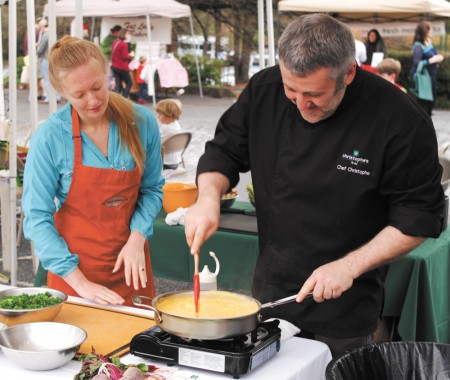 Chef Christophe Le Metayer, right, and Carmela Vivian, conduct a cooking demonstration at the Brookhaven Farmers Market on March 29. The market, located at Brookhaven Baptist Church, 1294 North Druid Hills Road, just opened for the 2014 season. Photo by Phil Mosier