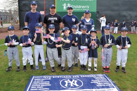 Nina Cramer, back, is the sole woman coaching baseball for a NYO team at Chastain Park. She's an assistant coach for the Yankees, which includes her 6-year-old son, Richard, front row right.