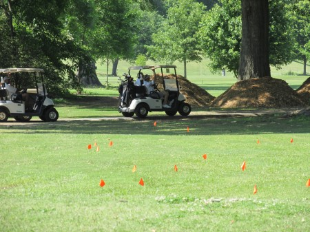 Red flags mark graves at Chastain Park's golf course.