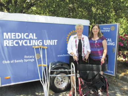 ann marie quill Rotarian Fran Farias, left, and Kathy Reed, executive director of Keep Sandy Springs Beautiful, with donated medical items.