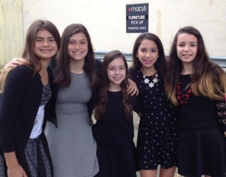"""Davis Academy seventh graders, from left, Abbi Goldberg, Joelle Zelony, Hannah York, Sophia Gurin and Isabelle McCullough, gained """"real world"""" working experience at Macy's."""
