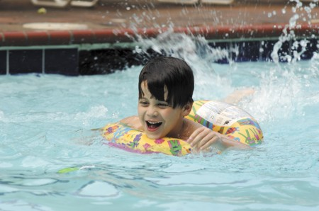 Bates Eden, 5, has a good time in The Branches Club swimming pool on June 6. Bates, a member of the club, was at the facility along with his twin brother, Jack, brother Oliver, who was celebrating a birthday, and father Jason.