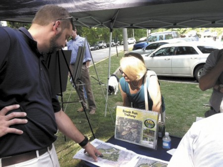 Parks and Recreation Manager Brent Walker, left, discusses dog park plans with residents last year.