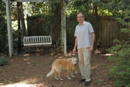 Randell Frostig and his dog, Allie, recently spotted a copperhead in the backyard of Frostig's Buckhead home.