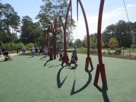 Children enjoy the playable art at the Abernathy Greenway.