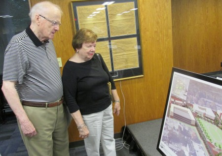 Sandy Springs residents Andy and Carol Heyward look at plans for a performing arts center.