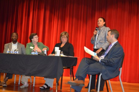 Atlanta Public Schools Superintendent Meria Carstarphen talks with parents at Sutton Middle School while, seated, left to right, Board Chairman Courtney English, Board member Cynthia Briscoe Brown, Board member Nancy Meister and Deputy Superintendent David Jernigan listen.