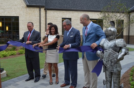 Arthur Blank, second from right, wields a sword on Aug. 18 to cut the ribbon on Pace Academy's new Blank Family Upper School. Tim Walsh, former chairman of the Pace board; Robert Sheft, co-chair of fundraising campaign for the $32 million building and current board chair; Elizabeth Richards, co-chair of the fundraising campaign; and Fred Assaf, head of school.