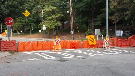 Barriers and detour signs remain around the sinkhole site at Chastain Park.