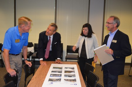 Left to right, Dunwoody City Councilman Denny Shortal, consultants Kirk Bishop and Leslie Oberholtzer, and Dunwoody Community Development Director Steve Foote examine photos of development styles during the kickoff meeting Sept. 4 of a effort to develop separate city zoning regulations for the Perimeter area in Dunwoody.