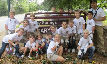 Students from Mount Vernon, along with teacher Chris Andres, helped improve the grounds at the Sandy Springs Library on Sept. 11, the National Day of Service.