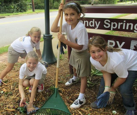 From left, Mount Vernon Presbyterian third-graders Cate Jacobson, Nina Brooks, Sydney Tiffin and Lauren Dove help plant flowers.
