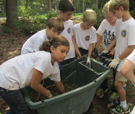 Mount Vernon third-graders collect weeds.