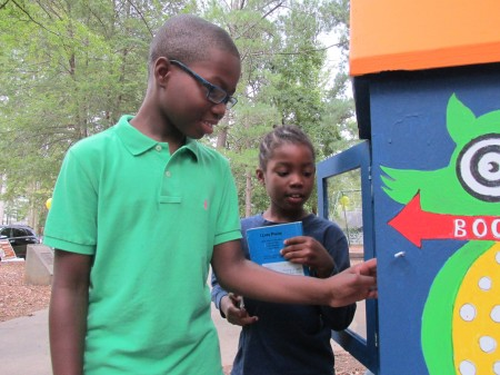 Brookhaven residents Tray and Olivia Middleton, students at Montgomery Elementary, check out books at the little library at Lynwood Park.