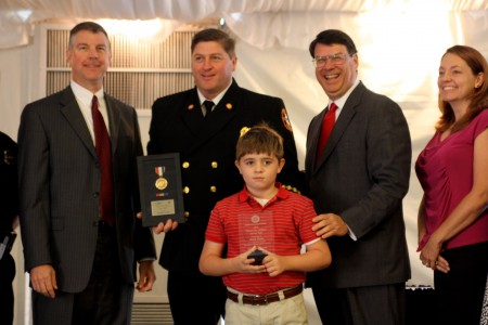 L to R: City Manager John McDonough, Chief Fire Officer of the Year Interim Deputy Chief Mark Duke, Duke's son (front), Mayor Rusty Paul and Duke's wife.
