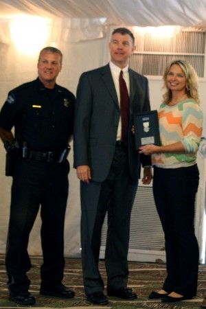L to R: Police Chief Ken DeSimone, City Manager John McDonough and Paramedic of the Year Firefighter Gina Ramey