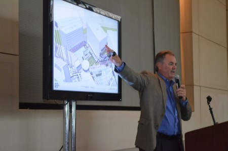 Atlanta Braves Executive Vice President of Business Operations shows members of the Sandy Springs/Perimeter Chamber drawings of possible development around the new Braves stadium in Cobb County.