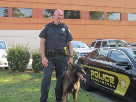 Officer John Ritch and K-9 Grizz are back on the job after a yellow jacket attack.