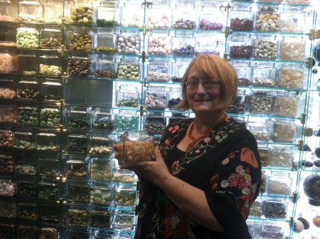 """Candace Apple, owner of Phoenix and Dragon on Roswell Road in Sandy Springs, sells metaphysical and spiritual books and gifts, candles, tumbled stones, oils and incense. Apple says her business is """"high touch, not high tech."""""""