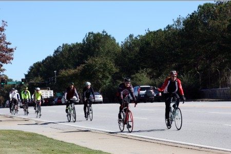A group of local bicyclists, activists and City Council members Joe Gebbia and Bates Mattison return to City Hall after a 5.8-mile bike ride around Brookhaven.
