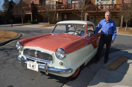 Ed Gerson proudly displays his 1956 Nash Metropolitan.