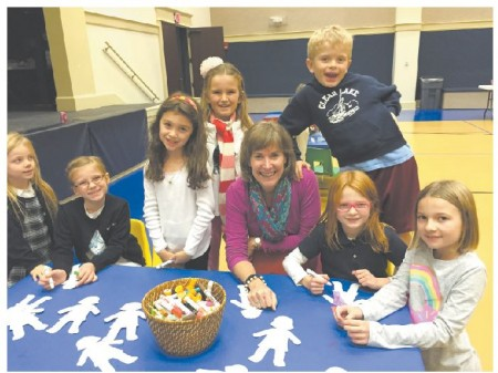 From left, Sydney McGoldrick, Elliott McGoldrick, Nina Gaitan, Clara Young, St. Luke's Director of Children's Ministries Catherine Anne Thomas, Cole Young, Carlisle Hearn and Allie Hearn enjoy activities at the day care facility.