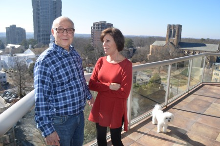 Joel Lobel, left, with wife Debbie and dog Lily, was reluctant to move into a condo. Five years ago his wife convinced him to move to the Gallery, a 27-story complex on Peachtree Road.