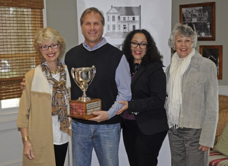 David Toolan, center left, and Hillary Johnson, center right, both of Oldcastle, accept the 2014 Dave Adams award from Dunwoody Nature Center Board President Su Ellis, left, and Pat Adams, founder of the Nature Center during the annual meeting of the Dunwoody Homeowners Association on Jan. 11, 2015.